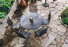 Round Glass Table on Stone Patio