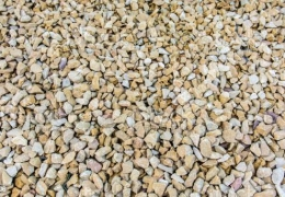 Layer of industrial stone aggregate on ground