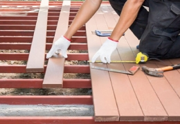 Contractor using tools to lay deck