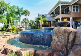 Boulder feature by swimming pool