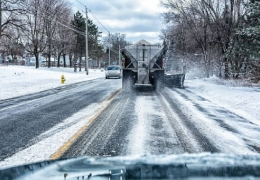 Commercial plow truck spreading salt